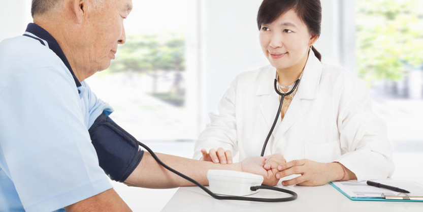 Doctor Checking Blood Pressure of an Elderly Patient