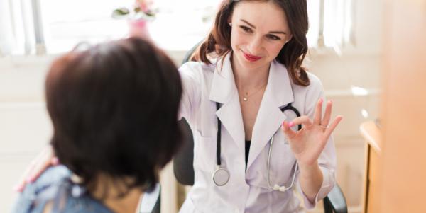 Doctor giving patient OK in Health Screening